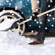 Man shovels snow from his driveway.